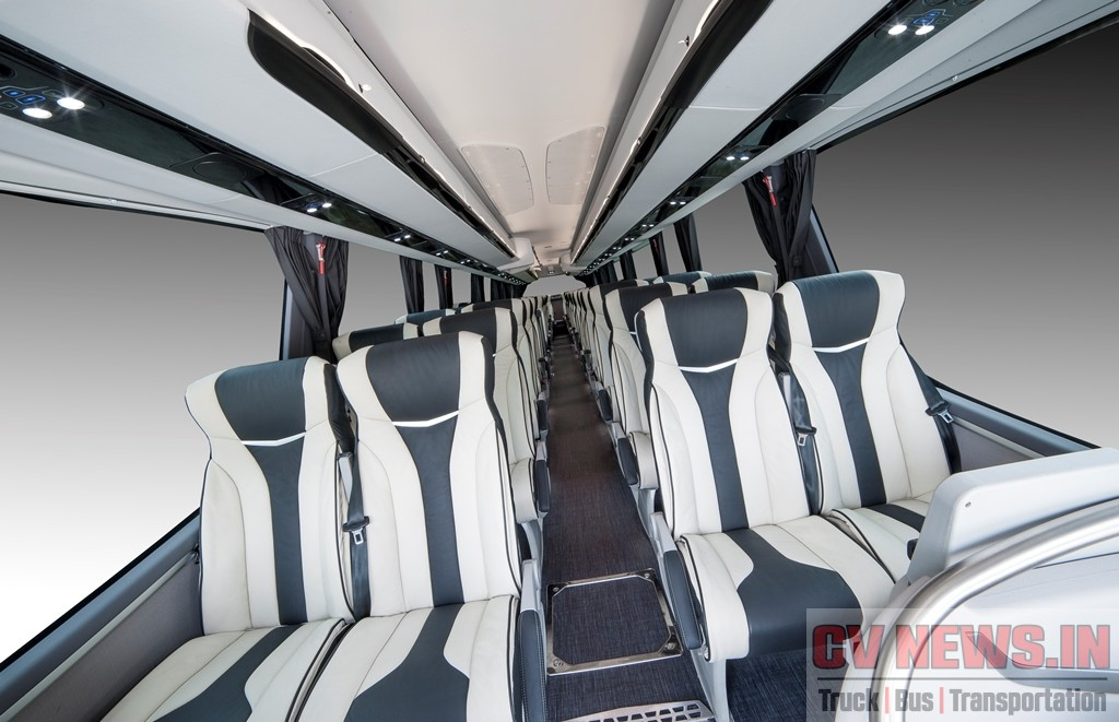 Irizar i8 seats in leather in 2+1 arrangement Extra-padded upholster,yLeather upholstery with double trim, Central armrests Magazine nets Aircraft style folder tables Four-point footrest, Three-point seat belts
